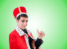 Affärsman som spelar konung mot lutningen Fotografering för Bildbyråer