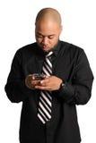 affärsman som texting Fotografering för Bildbyråer