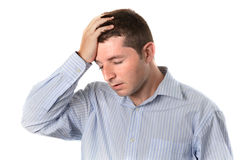 Affärsman över arbetad huvudvärk Arkivbild