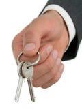 affärsmanhandholdingen keys s Arkivfoto