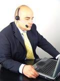 affärsmanhörlurar med mikrofon Arkivfoto