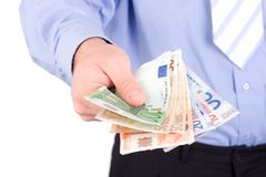 affärsmannen ger pengar Arkivbild