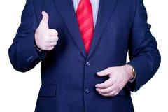 Affärsmannen i röd tieholding för dräkt tumm upp Royaltyfria Foton