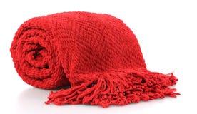 Afgan. Bright red fringed afgan on white background Stock Image