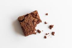 Afgebeten chocoladebrownie Stock Foto