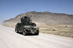 Afghan Army Patrol. Near Kabul in armored High Mobility Multipurpose Wheeled Vehicle with machine gun mounted Royalty Free Stock Photography