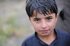 Afghan boy. An Afghan Boy in the Altimur village, Logar Province, Afghanistan, summer 2011 Stock Image