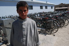 Afghan boy at a school. An Afghan young student standing at a new school, built by Czech Provincial Reconstruction Team in Logar Province, August 2009 Stock Photography