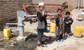 Afghan Children at Work Royalty Free Stock Photography