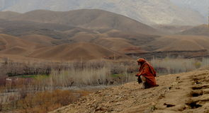 Afghan man and countryside Stock Photography
