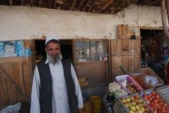 Afghan man at a market. Afghan man standing at a market in Baraki Barak district, Logar Province, November 2009 Stock Images