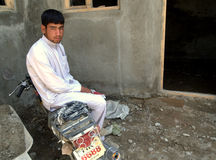 Afghan man sitting on a motorbike. In Jelga village, Logar Province, Afghanistan, July 2011 Stock Photography