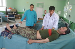 Afghan medical doctors. Medical doctors, members of the Afghan National Army, using the new firs aid room, built by the Czech Provincial Reconstruction Team in Royalty Free Stock Photography