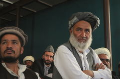Afghan men. Listening to governor´s speech at a meeting in Pol-e Alam, Logar Province, Afghanistan, June 2011 Stock Photo