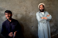 Afghan men. Portrait of two Afghan men standing at the site of Czech Provincial Reconstruction Team´s project of Milk Collection Center in Logar Province Stock Image