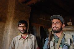 Afghan men in a bakeshop. In Baraki Barak district, Logar Province, Afghanistan, November 2009 Stock Image