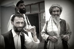 Afghan men drinking tea. An Afghan men drinking tea in Pol-e Alam, Logar Province, Afghanistan Royalty Free Stock Photo