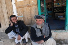 Afghan men sitting at a market Stock Images