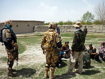Afghan military officer interrogating locals Stock Image