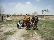Afghan military officer interrogating locals Royalty Free Stock Photo