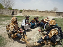 Afghan military officer interrogating locals Stock Photos