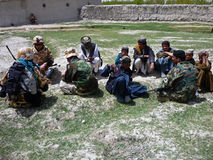 Afghan military officer interrogating locals Stock Photography