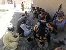 Afghan military officer interrogating locals Royalty Free Stock Image