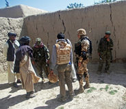 Afghan military officer interrogating locals Stock Photo