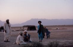 1975. Afghanistan. Afghan nomads. The picture shows some friendly afghan nomads, having a conversation Royalty Free Stock Photography