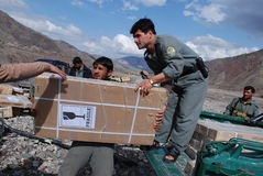 Afghan police in Logar Province. Members of Afghan National Police transporting solar panels for a local hospital, donated by Czech Provincial Reconstruction Stock Image