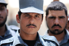 Afghan policemen. You can see some Afghan policemen. I made this picture on a training camp in Eastern-Afghanistan. This camp led by US Royalty Free Stock Photos