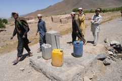 In the Afghan village. Chinarey village in Logar province, Afghanistan (summer 2011). Czech Republic´s Provincial Reconstruction Team (PRT) built a new waters Stock Photos