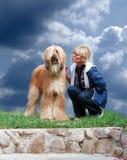 Afghanisch-Hund und Frau Lizenzfreie Stockbilder
