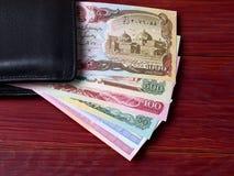 Afghanischer Afghani in der schwarzen Geldbörse Lizenzfreie Stockfotos