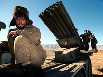 AFGHANISTAN. CHARIKAR, AFGHANISTAN,  17 OCTOBER 1996 - A soldier loyal to northern Afghani warlord Dostum sits atop  a mobile rocket launcher just north of the Royalty Free Stock Photo