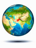 Afghanistan on Earth with white background. Afghanistan in red on model of planet Earth hovering in space. 3D illustration isolated on white background. Elements stock images