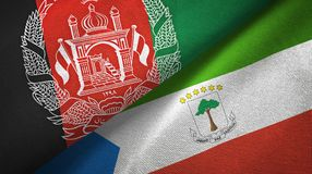 Afghanistan and Equatorial Guinea two flags textile cloth, fabric texture. Afghanistan and Equatorial Guinea two folded flags together royalty free illustration