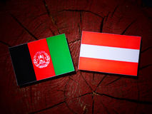 Afghanistan flag with Austrian flag on a tree stump  Royalty Free Stock Photography