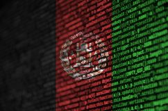 Afghanistan flag is depicted on the screen with the program code. The concept of modern technology and site development.  stock photography