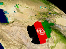 Afghanistan with flag on Earth Royalty Free Stock Images