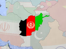 Afghanistan with flag on globe Royalty Free Stock Images