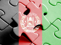 Afghanistan  FLAG PAINTED ON PUZZLE nice. Afghanistan  FLAG PAINTED ON PUZZLE Stock Images