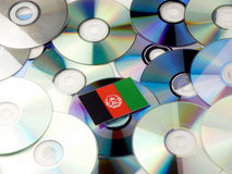 Afghanistan flag on top of CD and DVD pile isolated on white. Afghanistan flag on top of CD and DVD pile isolated Royalty Free Stock Photo