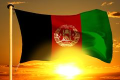 Afghanistan flag weaving on the beautiful orange sunset with clouds background. Afghanistan flag weaving on the beautiful orange sunset background stock images