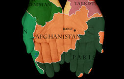 Afghanistan In Our Hands. Map Painted On Hands Showing The Concept Of Having Afghanistan In Our Hands Royalty Free Stock Images