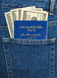 Afghanistan passport and dollar bills in the jeans pocket Royalty Free Stock Image