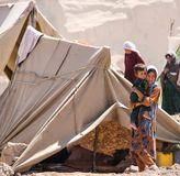 Afghanistan refugee camp children in the North West in the middle fighting season. Afghanistan refugee camp life and children in poverty in the desert heat in stock photo