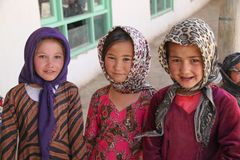 Afghanistan village children in the North West in the middle fighting season. Afghanistan village life and children in poverty in the desert heat in the North of royalty free stock photo