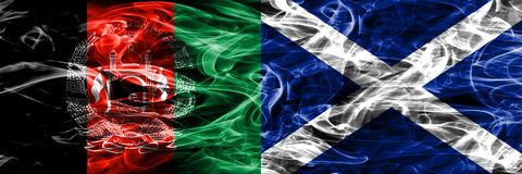 Afghanistan vs Scotland smoke flags placed side by side. Thick colored silky smoke flags of Afghani and Scotland. stock images