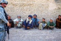Afghans Joking with Interperter Royalty Free Stock Image